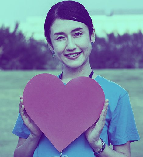 young woman holding heart